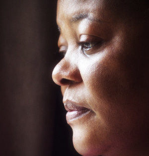 portrait of mature woman of African descent with thoughtful expression